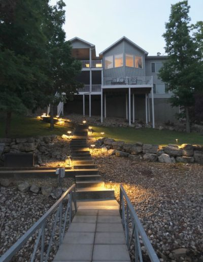 view of a lakefront home from dock walkway